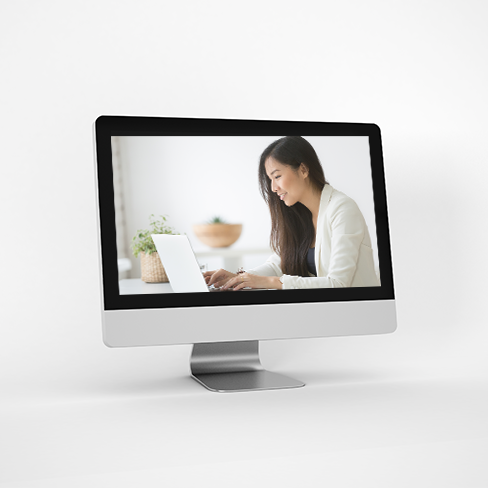 image of a computer screen which shows a woman working on a laptop